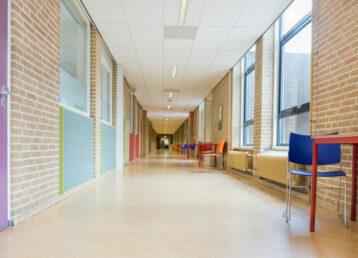 Long corridor with furniture in school building